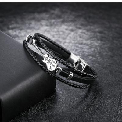 Кожаный браслет с плетением и металлической вставкой в виде гитары PLB-10